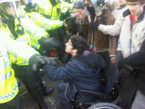 Jody McIntyre just before Police dragged him out of his wheelchair