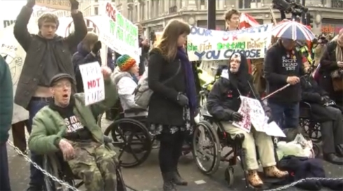Disabled people stop the traffic in London's Oxford Circus (28-01-2012) in protest of the governments cuts to welfare benefits